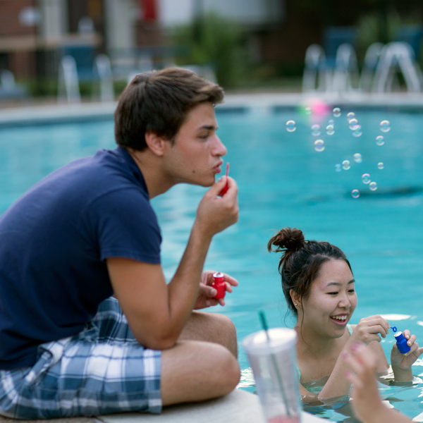 two student blowing bubbles at Milbrook Pool