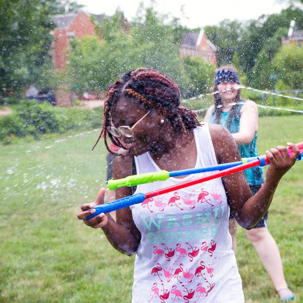 students participating in summer water battle