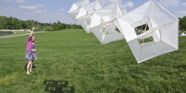 student flying kite on Art Hill